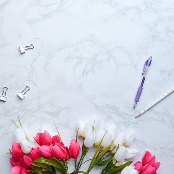marble flowers pen and clips flat lay photograph of desk for bloggers